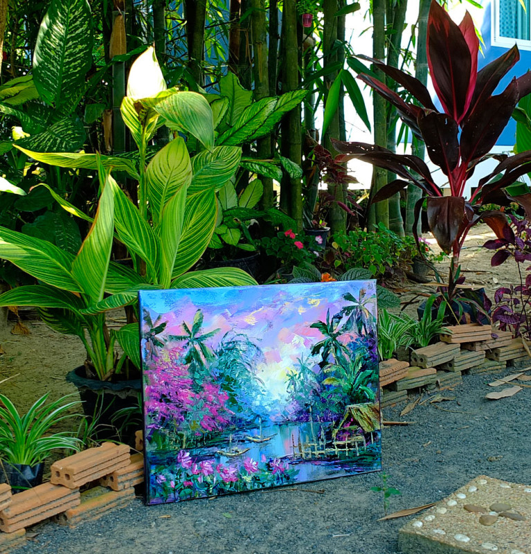 Картина в окружении тропических растений